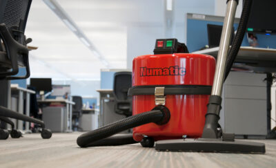 Numatic Commercial Dry Steel Top Vacuum In An Office